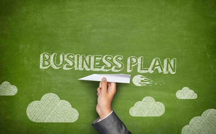 business plan written on green background