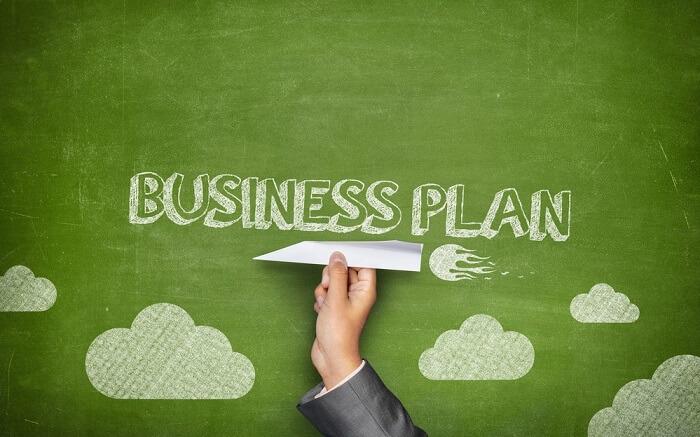 business plan written on green background