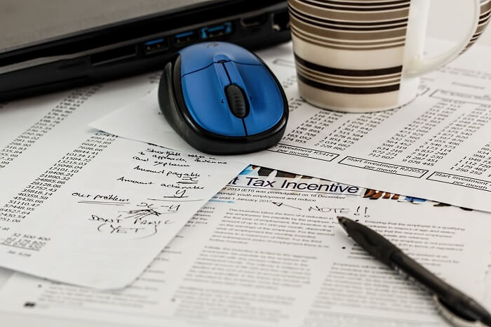 revenue papers with mouse