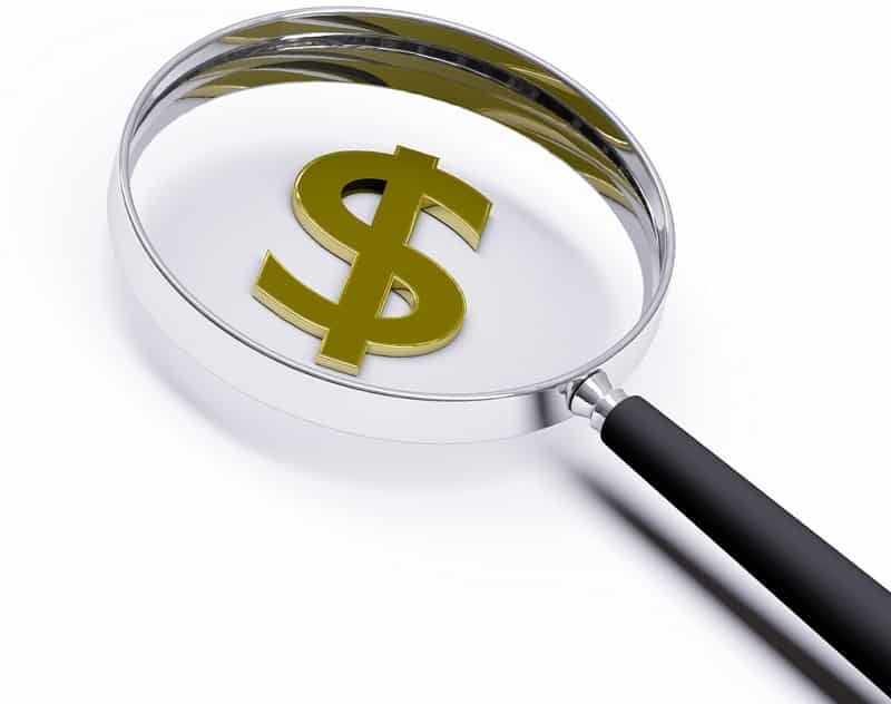magnifying glass over a dollar sign