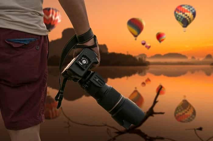 man with a DSLR camera at sunset