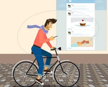Handsome guy is riding a bike and checking his account in twitter