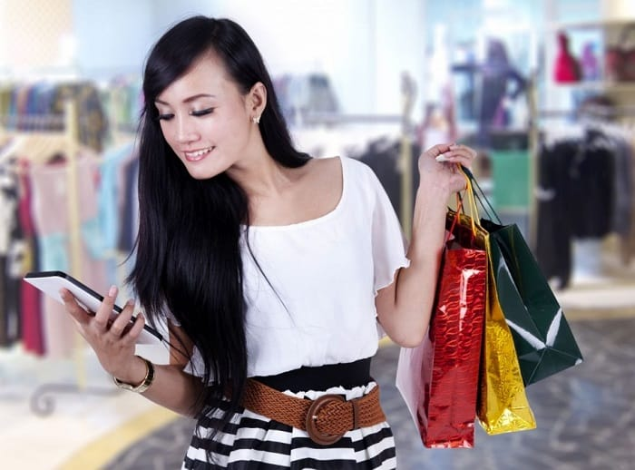 asian woman looking at tablet