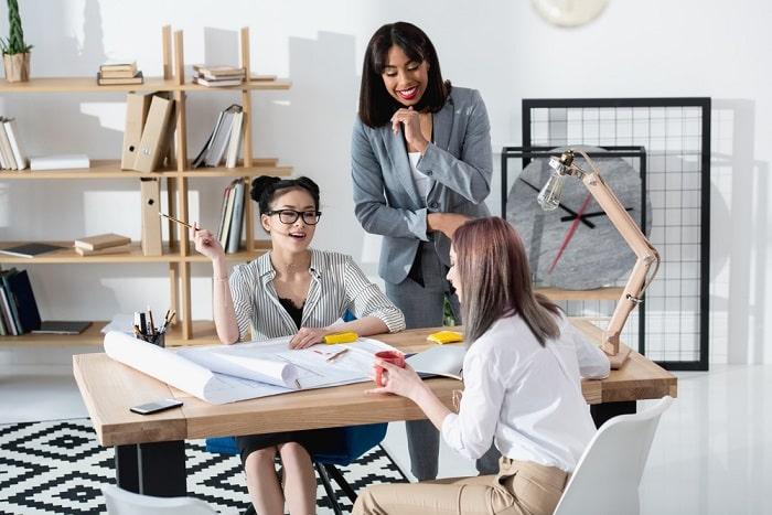 women in small office