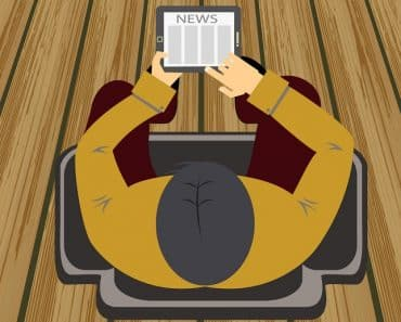 Man Reading Newspaper from tablet