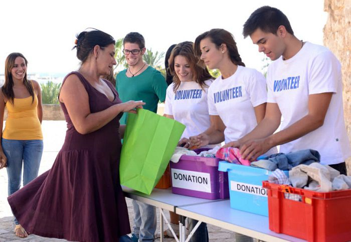 group of volunteers collecting clothes