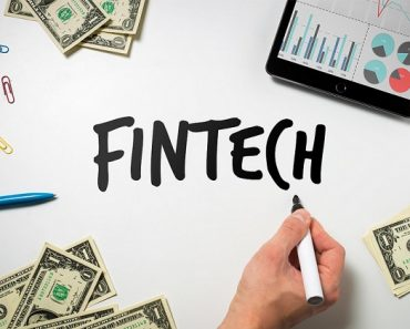 Writing FinTech on a table