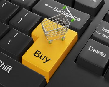 Enter key with the word buy on it and a shopping cart above