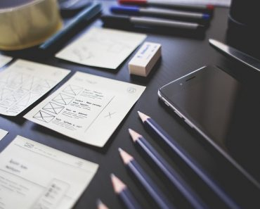 Pencils, erasers, and papers on a desk