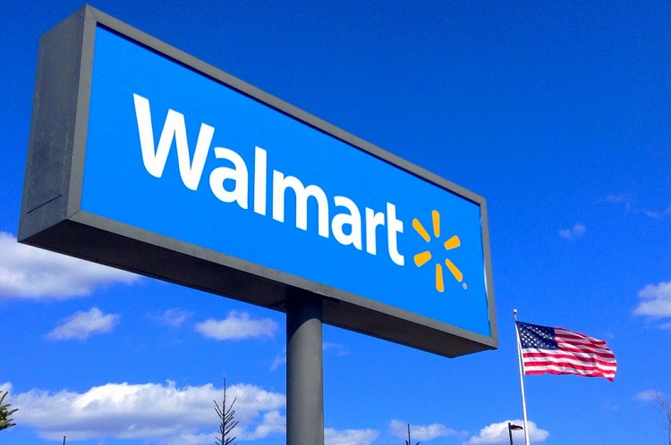 Walmart sign next to the American flag