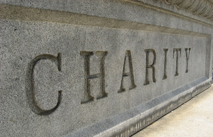 The word charity carved into stone