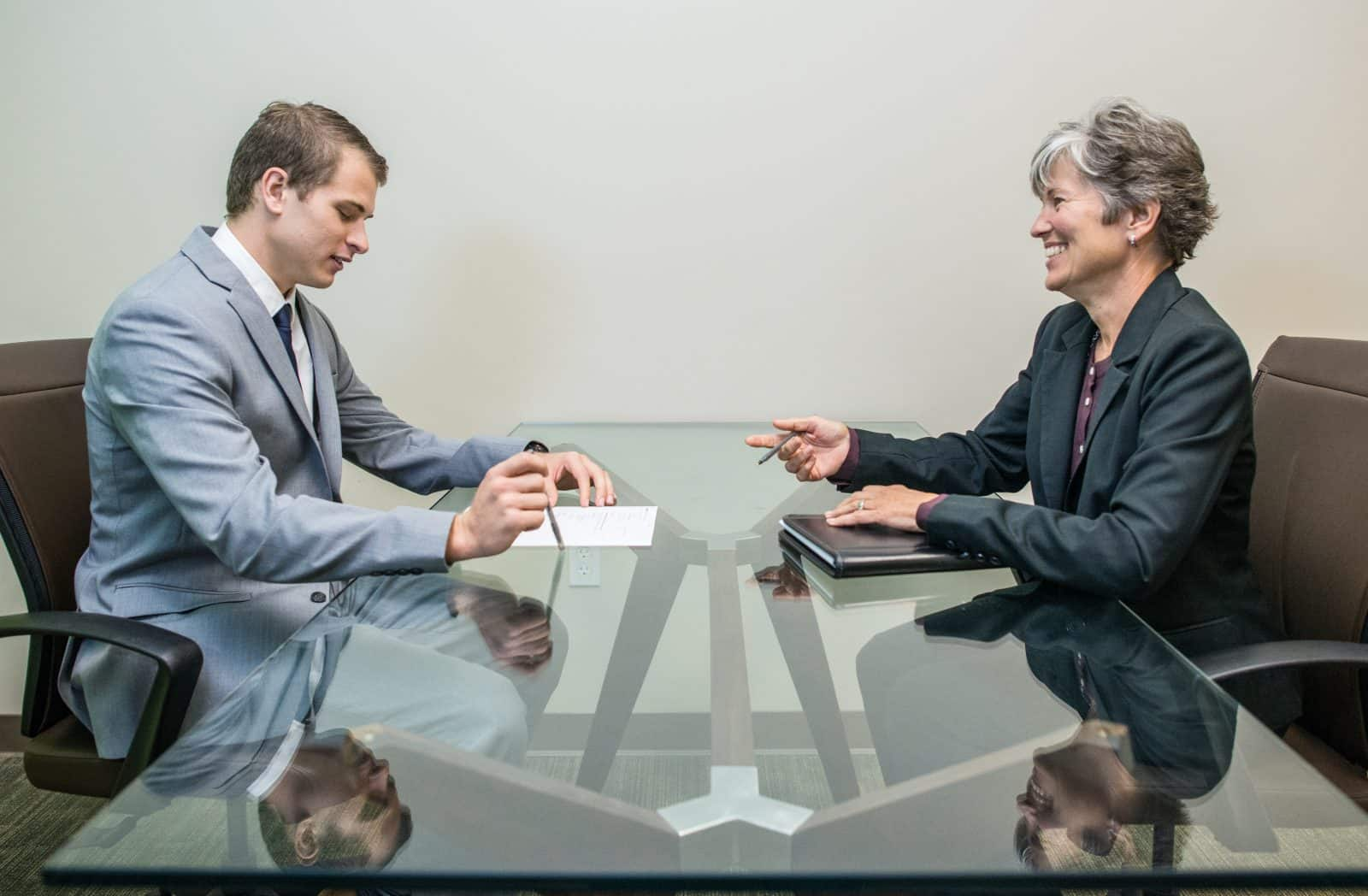 Young man during an interview with a woman