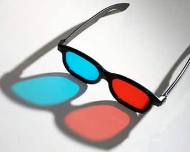 3D glasses casting a colorful shadow on the table