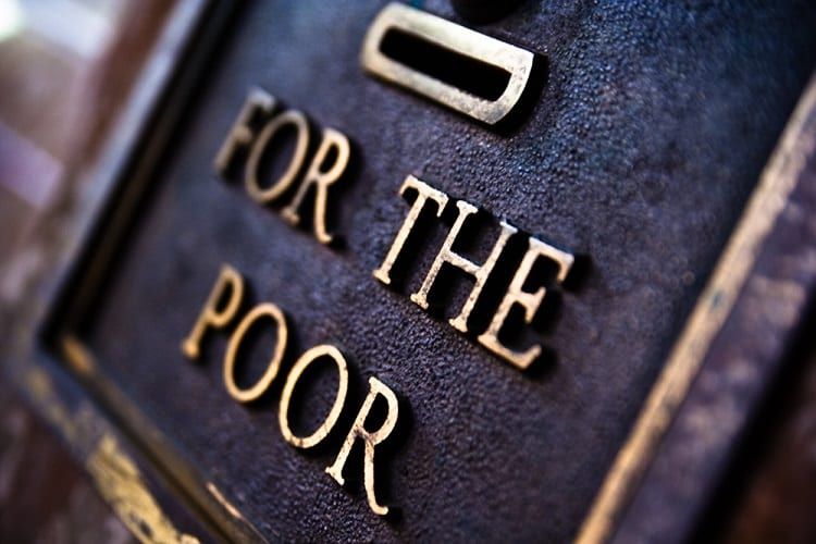 """Donation box with the words """"For the poor"""" engraved on it"""