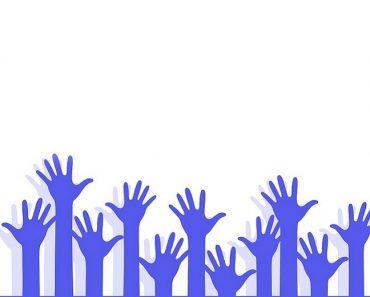 Volunteering hands stretched above
