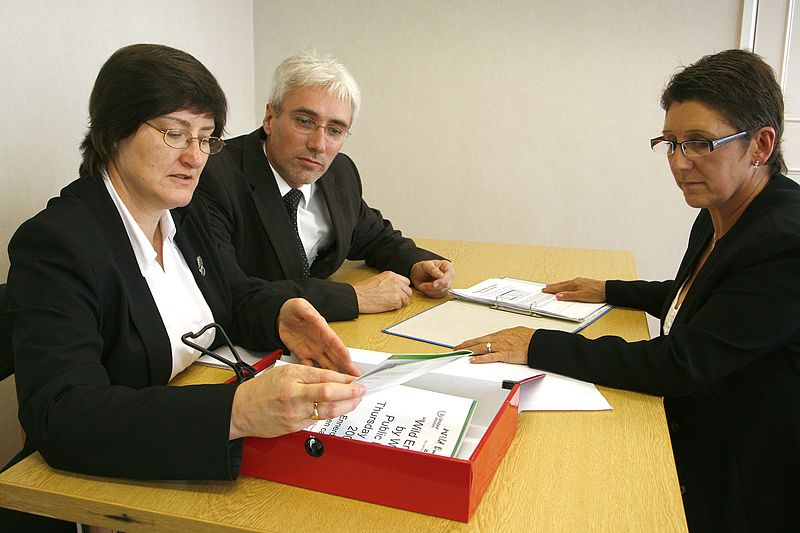 People sitting at a desk during a job interview
