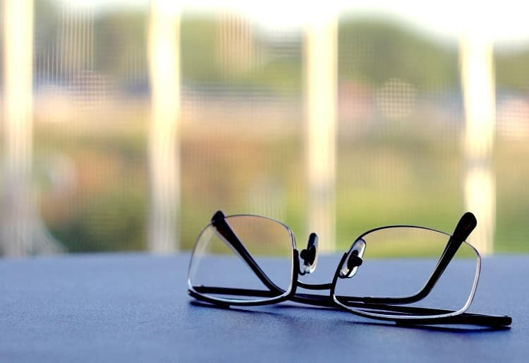 Reading glasses placed on an outdoor table