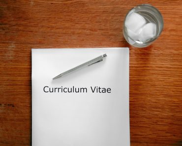 Resume placed next to an ice water glass