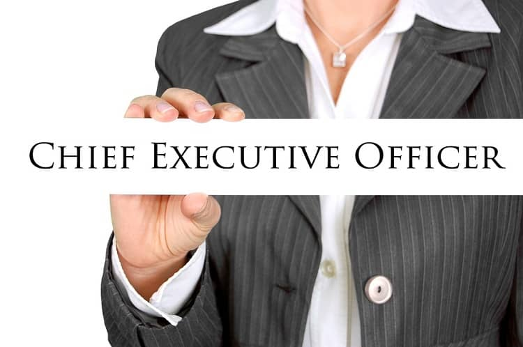 Businesswoman holding a Chief Executive Officer sign