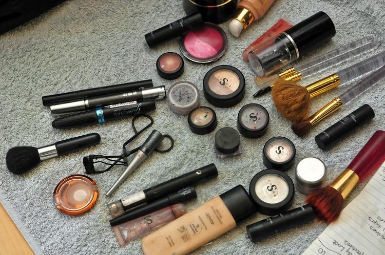 Make-up cosmetics spread on a carpet