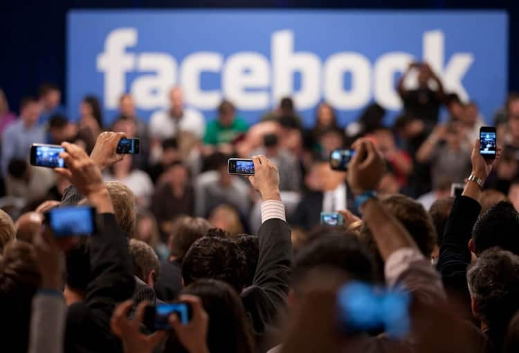 People photographing a Facebook conference