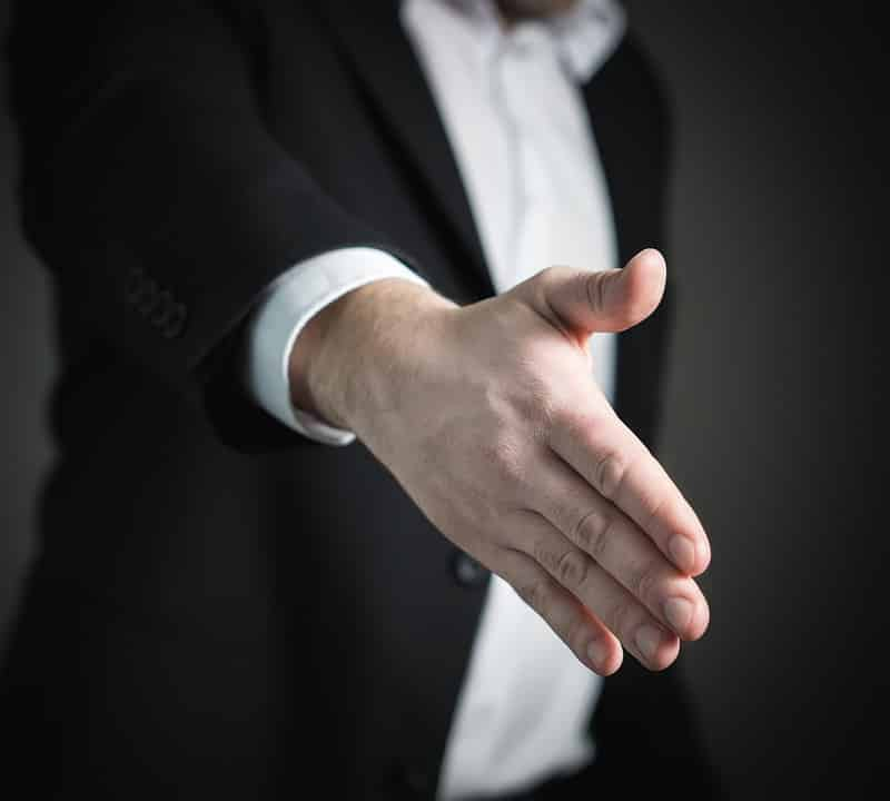 Man stretching his hand for a handshake