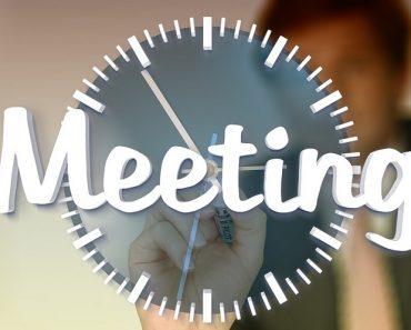 Meeting doodled over a clock