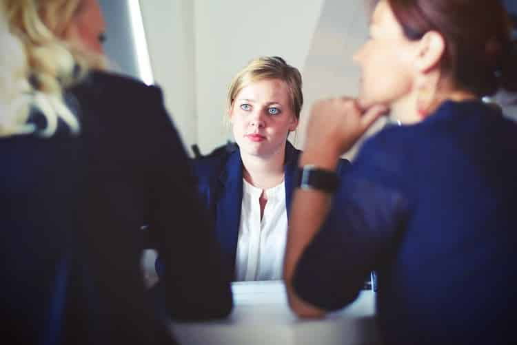 Woman sitting in front of two other women at an interview