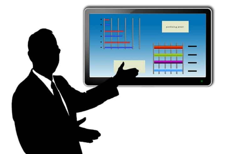 Businessman giving a presentation on a screen