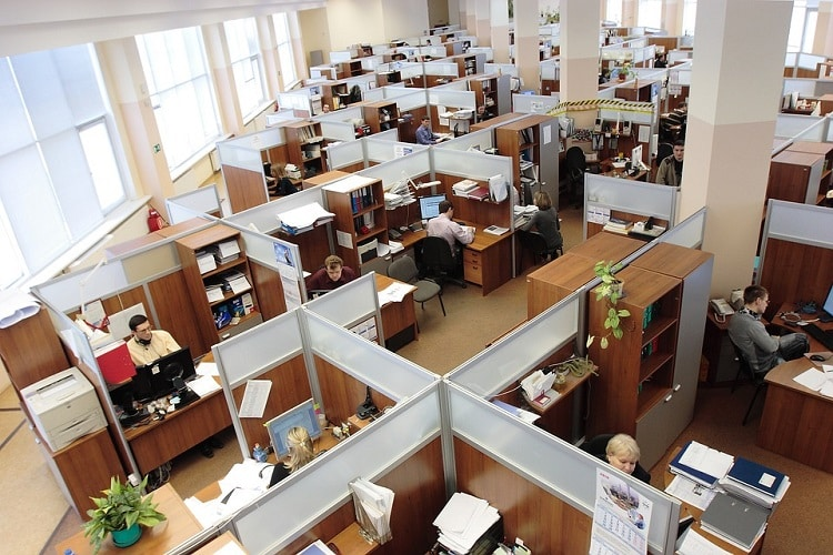 A big office with people working in cubicles