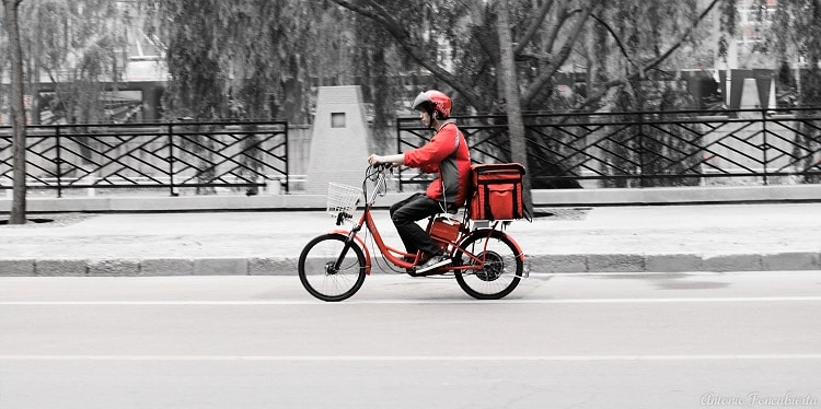 Person riding a bike making a delivery