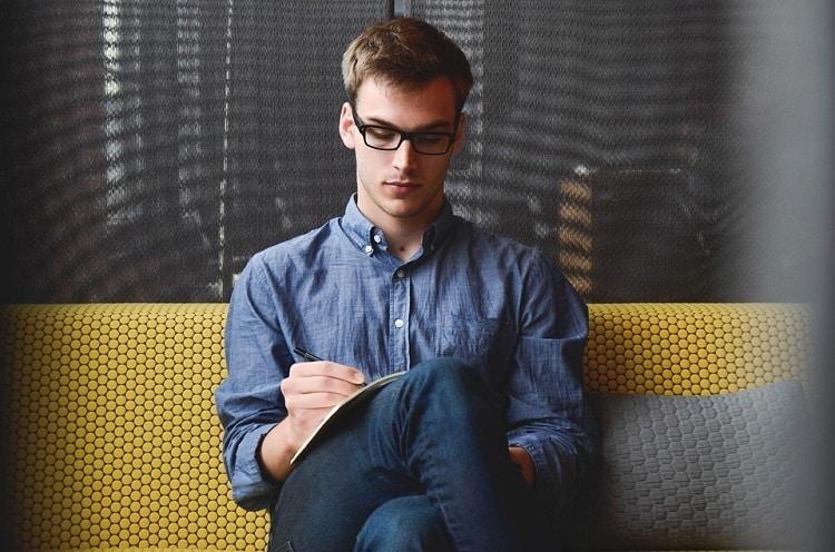 Freelancer writing on a notebook