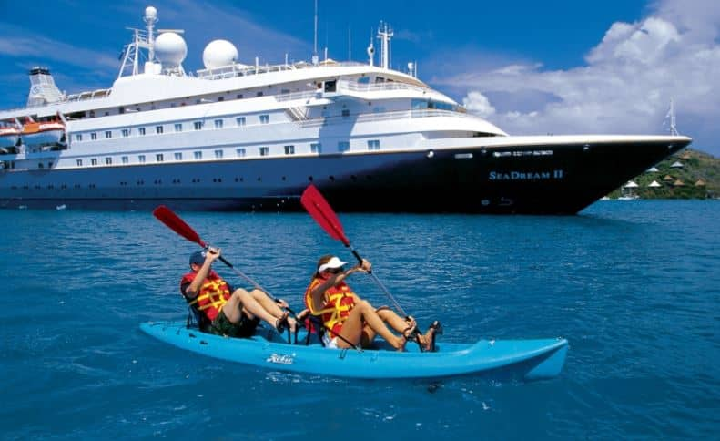 Getting a patent can free up time to do things you love Photo is couple kayaking along near luxury cruise liner