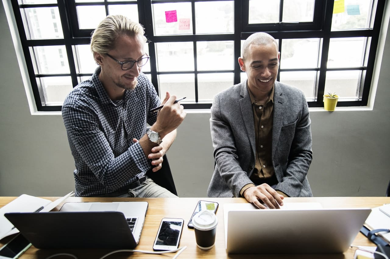 Two men collaborate at work: Relationships matter when it comes to employee engaement