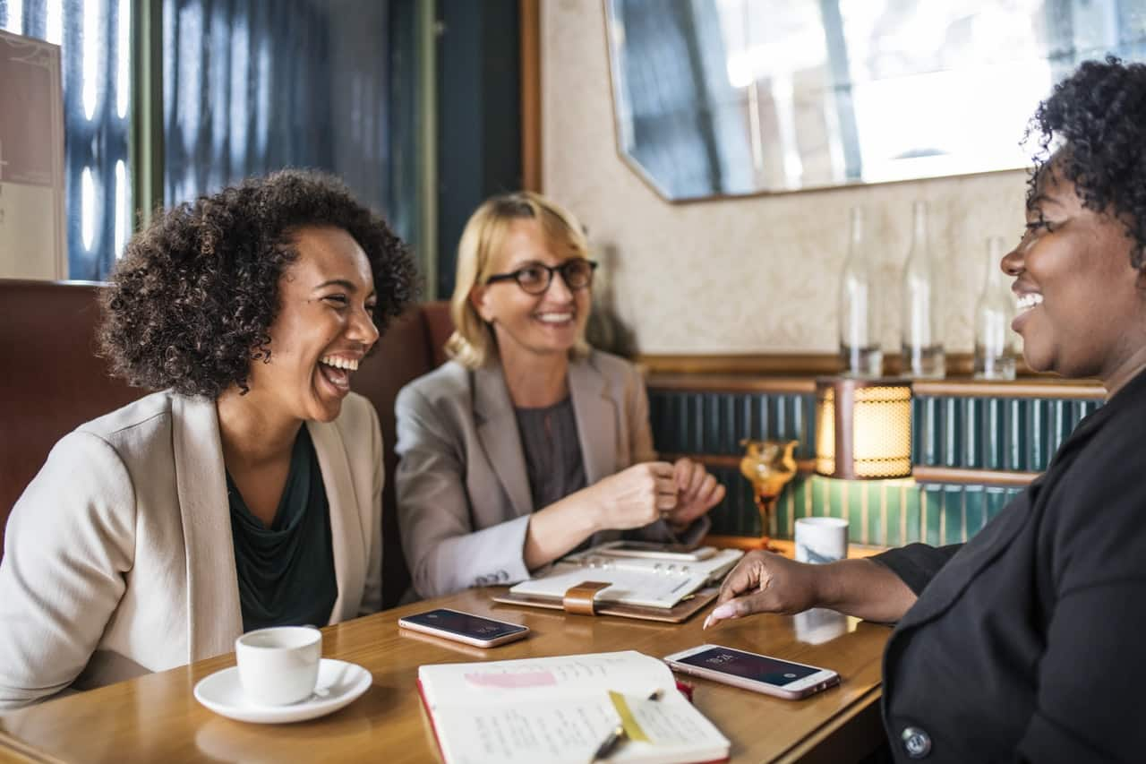 Office workers have lunch together: encourage friendships for true employee engagement