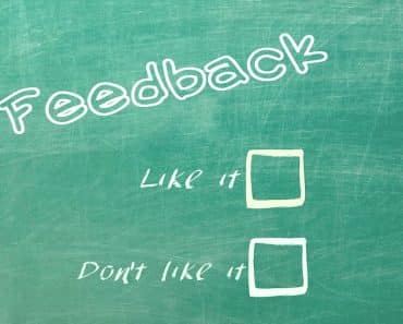 "A chalkboard with ""feedback"" writing across it and two boxes to check. Someone leaving a product review will mark the box for ""like it"" or ""don't like it."""