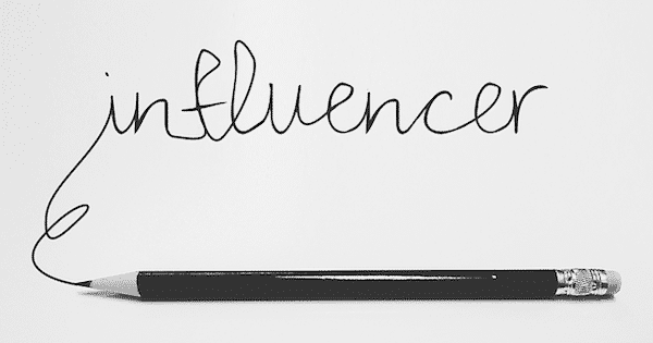 product review influencer written in pencil on a white piece of paper.