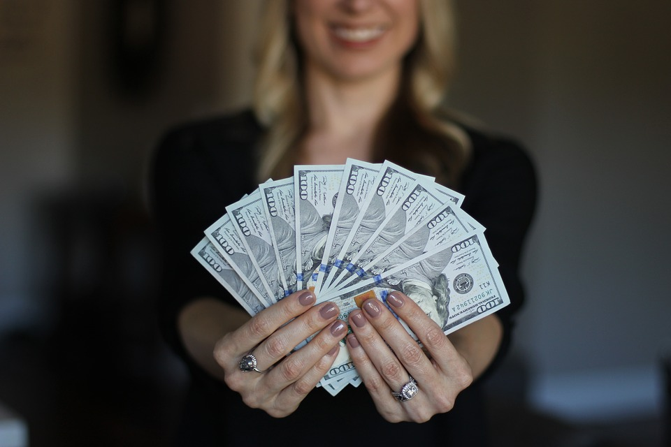 how to value a business - woman holding money