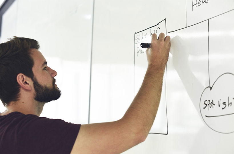 Man charting on the board