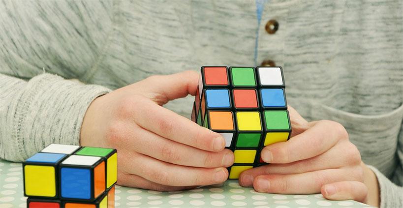 Man solving a magic cube