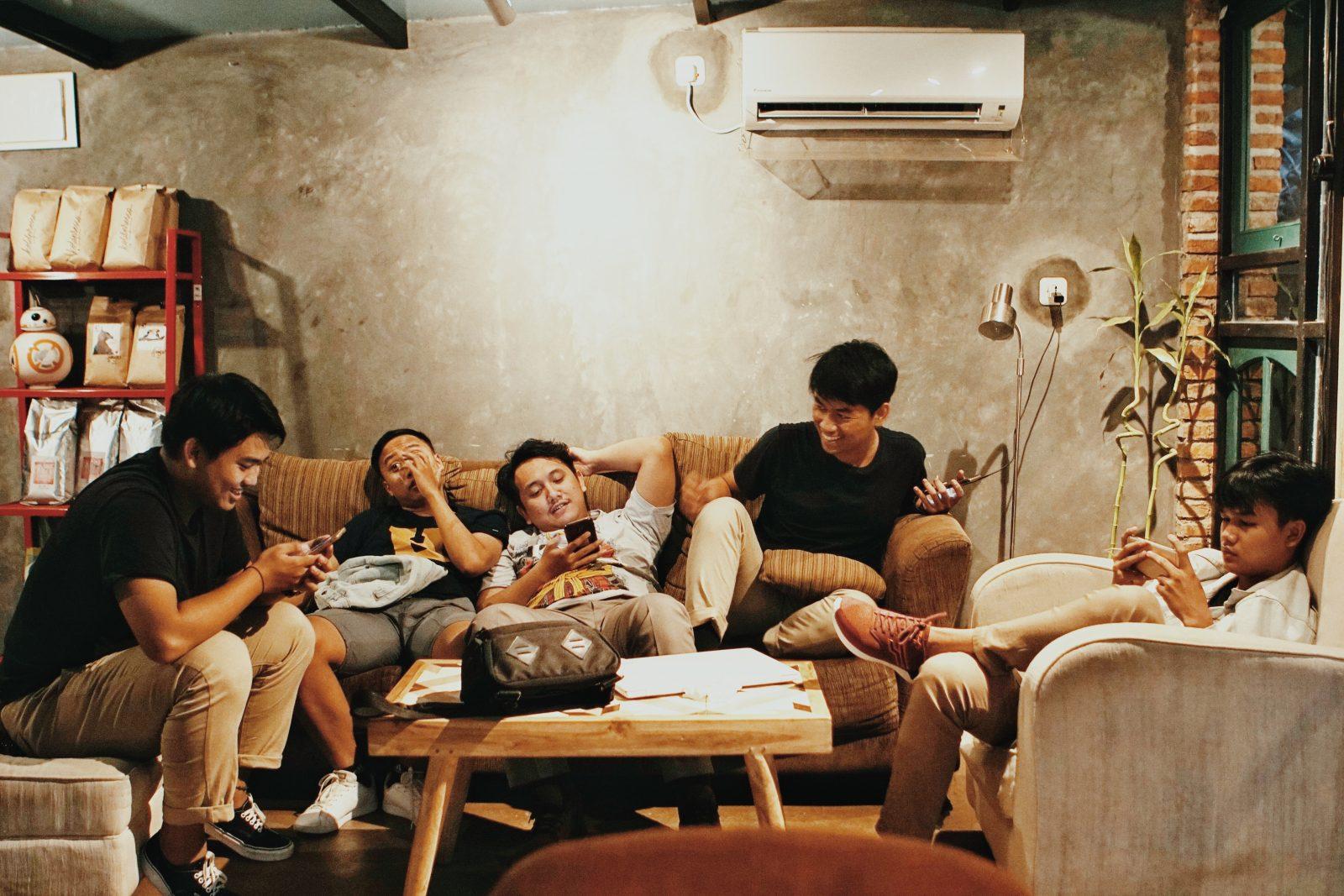 Men sits sofa